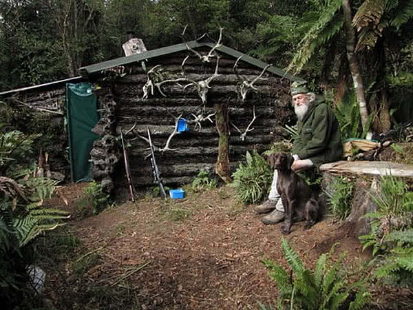 Kiri and dear friend. Typical NZ deer hut.