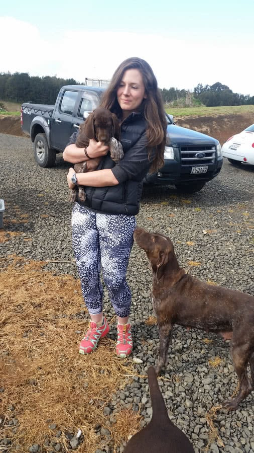 Mesha saying good bye to her pup as the new owner claims it.